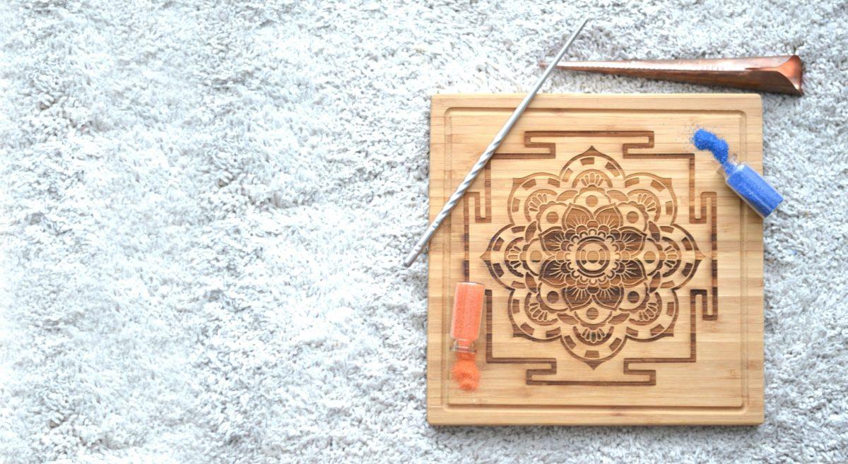 sand mandala art design on wood